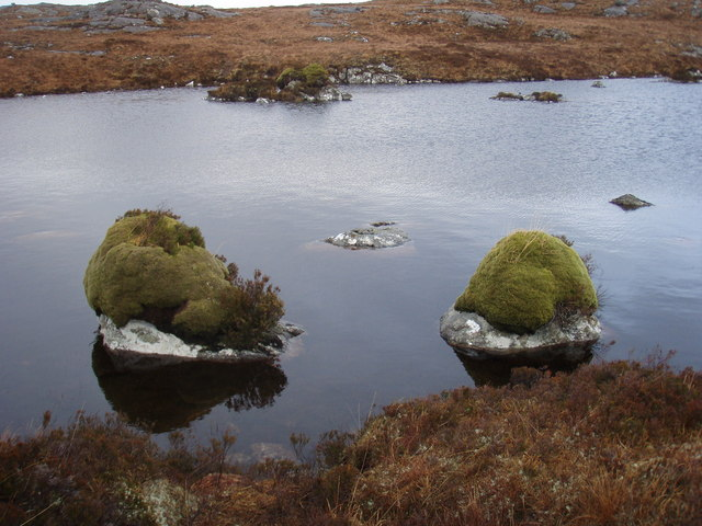 Moss capped boulders in unnamed loch