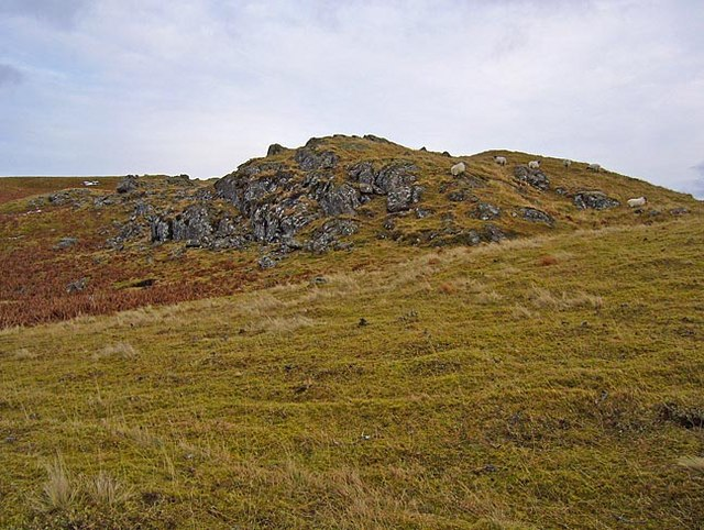 Crag and sheep near Balmuick