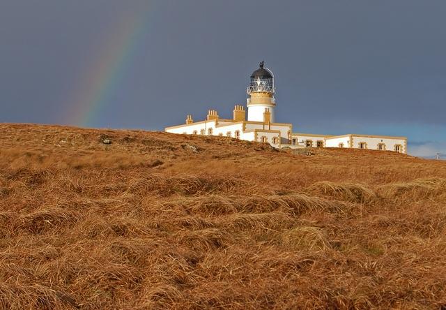 Neist Lighthouse under a storm sky