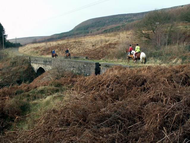 Horse riders on Rhodeswood Reservoir bridleway path