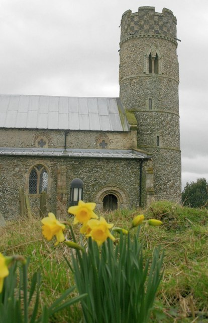 Early daffodils welcome the worshipper to St. Mary's, Haddiscoe