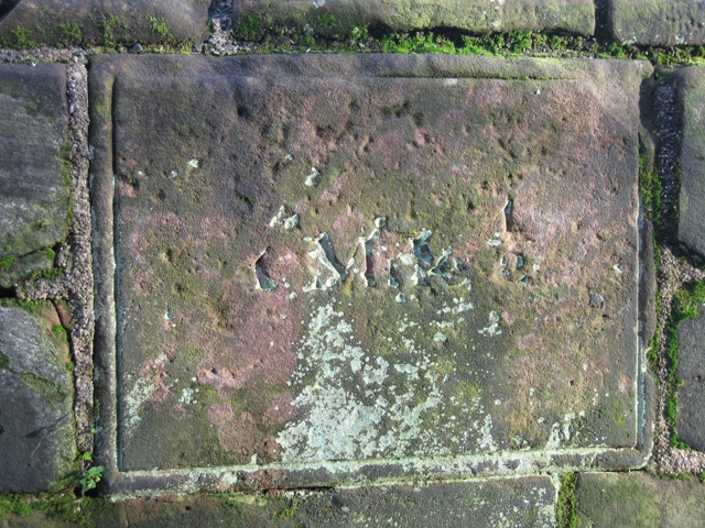 Distance marker on the city walls - 1 mile ½