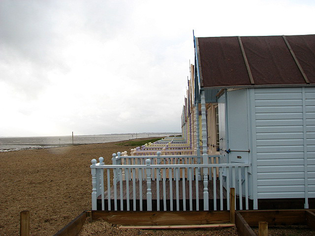 View southwest along pastel-coloured beach huts