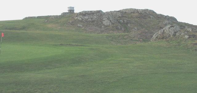 View west across the golf links towards the mothballed Coastguard station on Trwyn Porthdinllaen