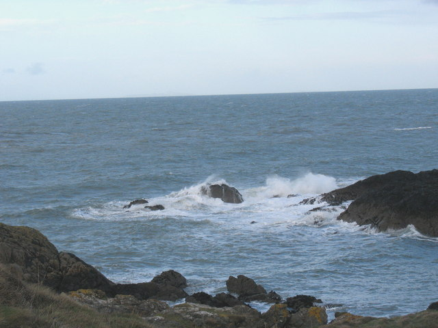 Waves breaking on the western tip of the Carreg Ddu rocks