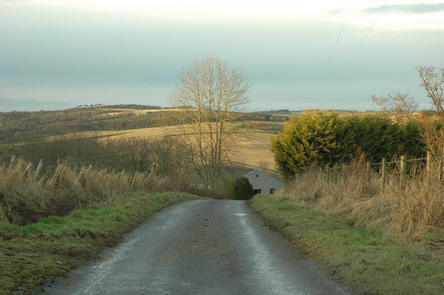 Country road descending into the valley of the river Deveron