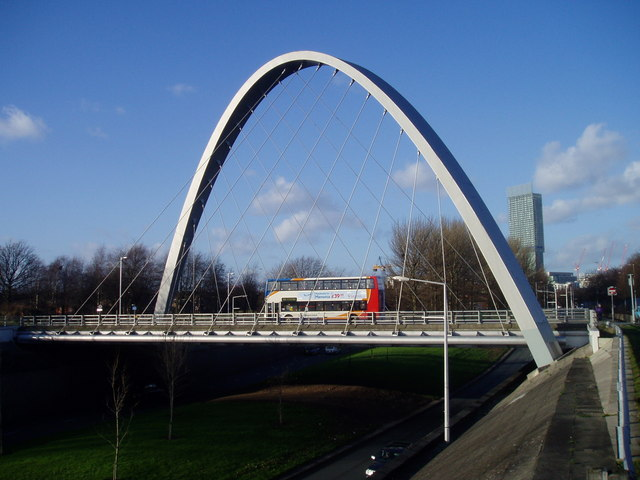 Hulme Arch, with a Stagecoach bus crossing Princess Parkway