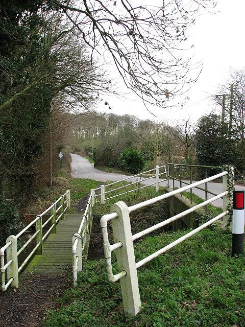 Road and footbridge across the River Tud