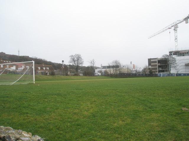 Football field overshadowed by QA