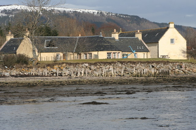 The Storehouse at Foulis Ferry with a snow-capped Fyrish Hill