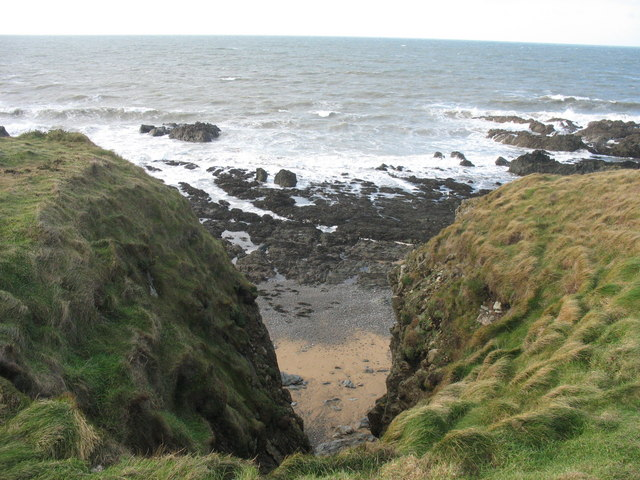 A small sandy cove formed by differential erosion