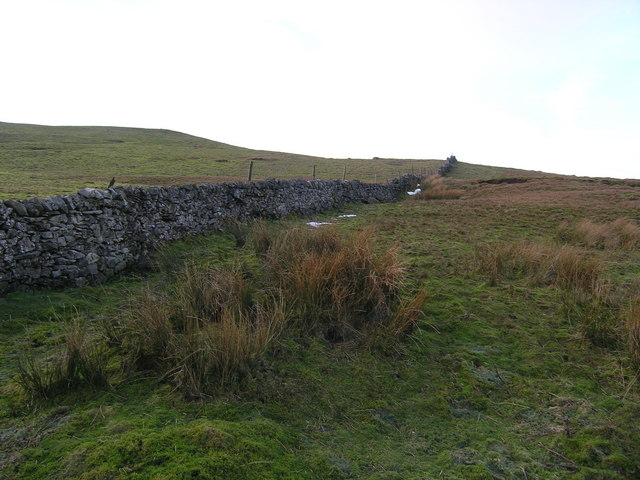 Dry stone wall heading up to Ley Seat