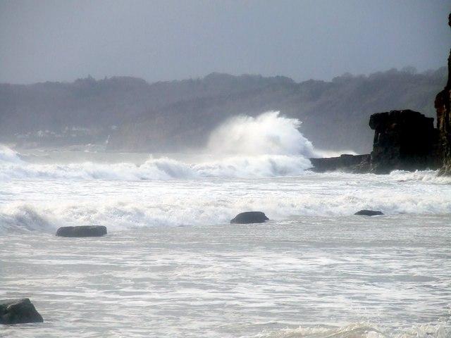 Waves breaking at western end of Telpyn Beach