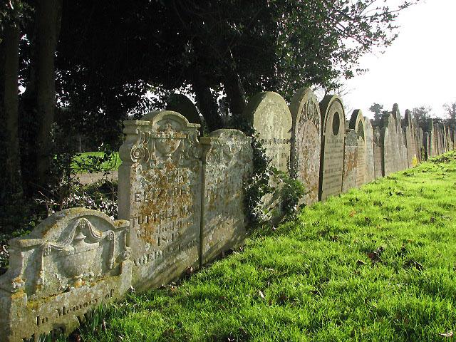 St Andrew's Church  - row of gravestones in churchyard