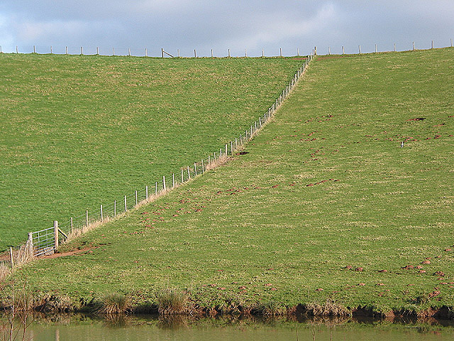 Fence sweeping down a hillside