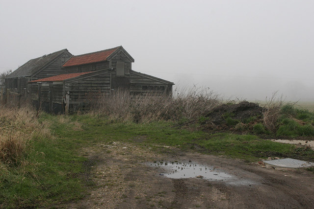 Timber barns beside footpath at Kitty's Farm