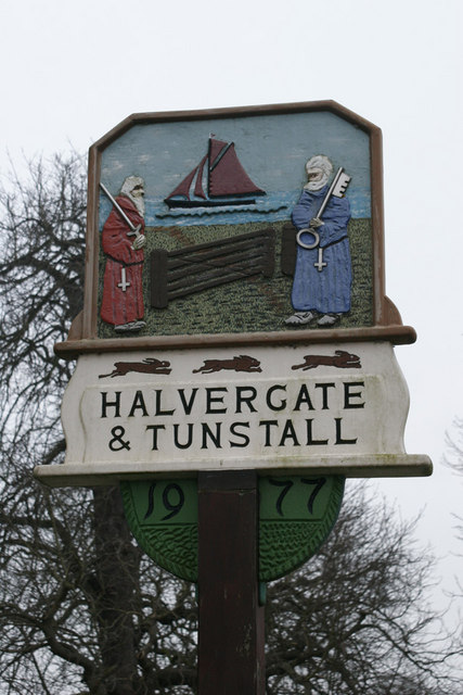 Village sign depicting SS Peter and Paul