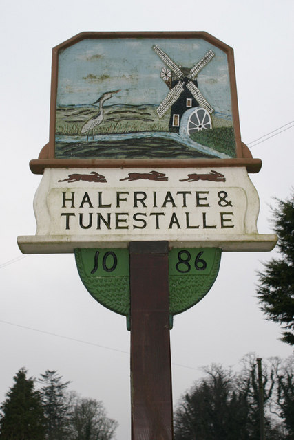 Village sign showing spelling from 1086
