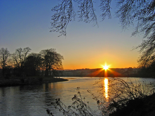 Sunset over Peterculter golf course and the river Dee