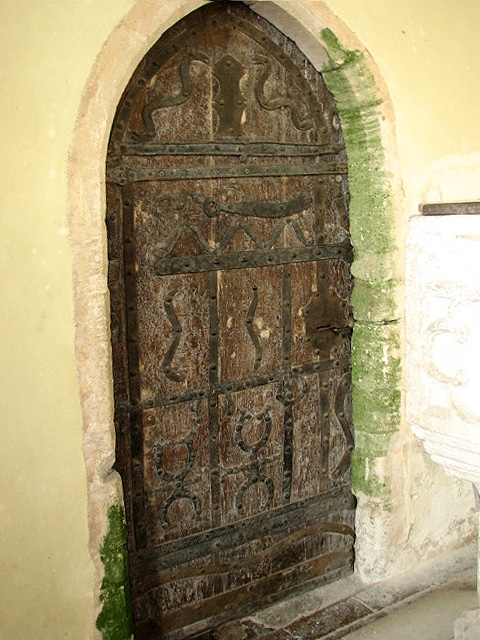 The Church of All Saints - 12th century door with ironwork