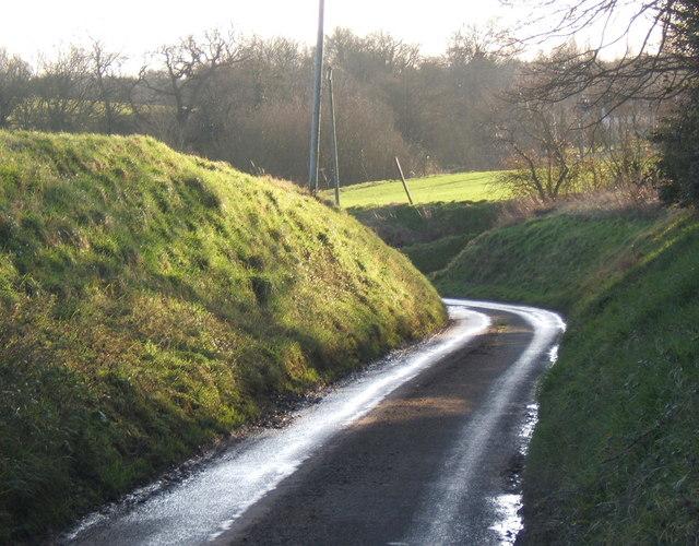 Spring Lane curves past steep banks