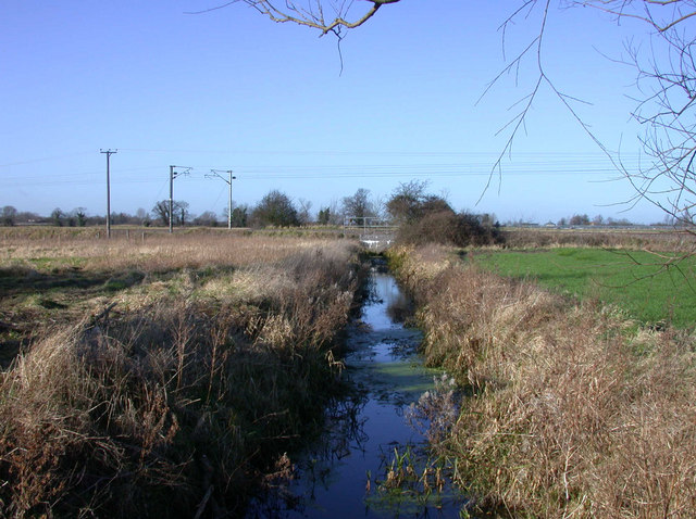 Drainage ditch and railway wires