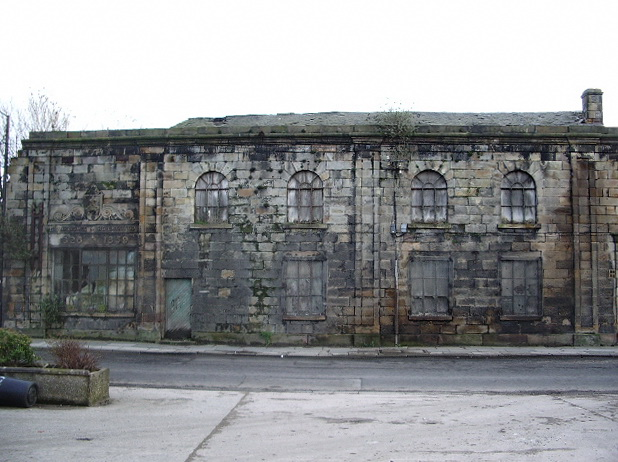 Face of a derelict building on New Quay Road