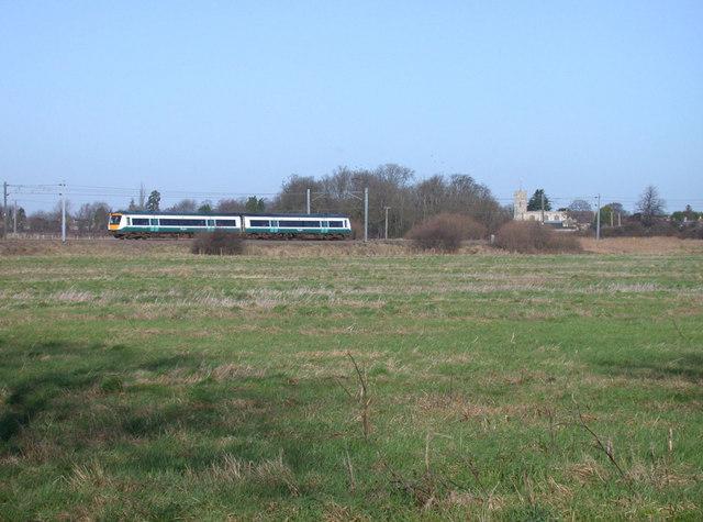 """one"" train passing Waterbeach church"