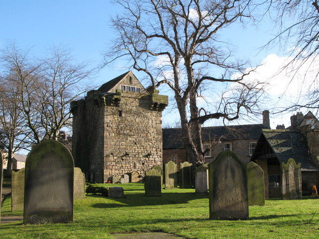 The graveyard of St. Andrew's Church and the Vicar's Pele