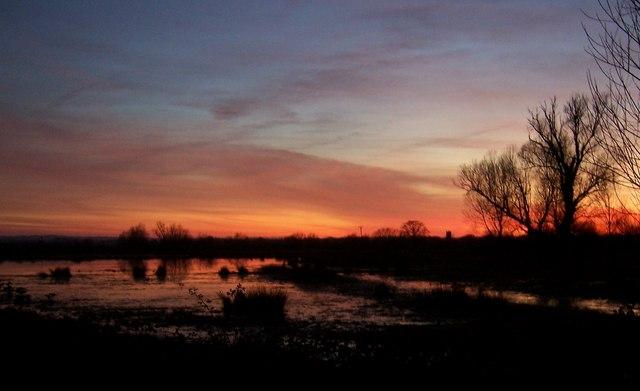 Sunset over flooded fields