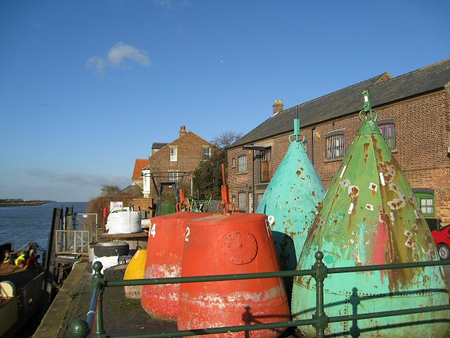 Old buoys huddled together on the quayside