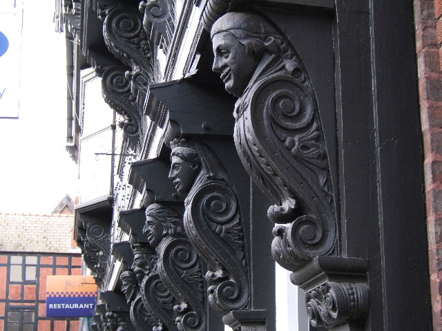 Carved Figures on a Black and White Building