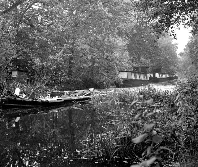 Derelict and vandalised abandoned houseboats, Basingstoke Canal