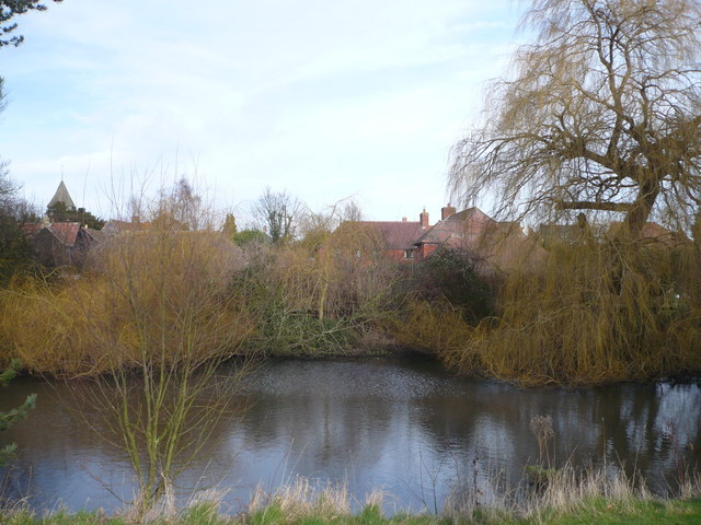 Looking across the pond to Lynsted, with the church in the distance