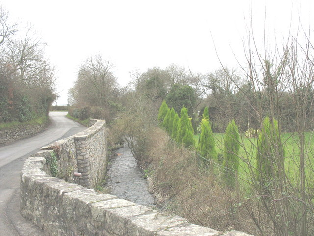 Afon Rhyd-hir a minor road and an ornamental garden