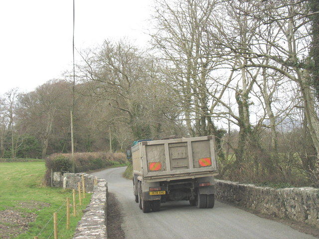 Agricultural merchants' lorry negotiating narrow country road near Pont-y-Gribin Farm