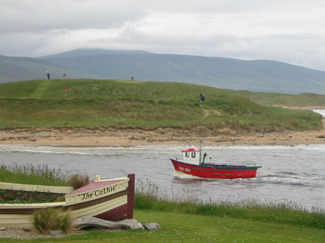 Cathie looks on as boat enters Brora Harbour