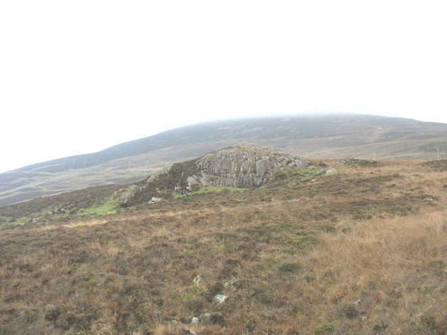 Rock outcrop above Craig Ddu with the central peak of Yr Eifl in the background