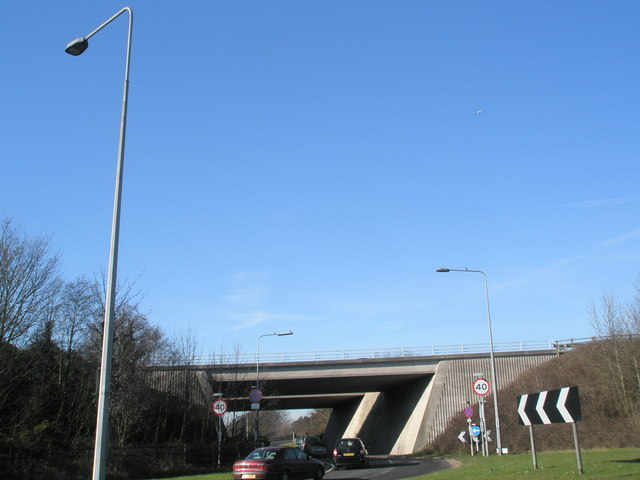Local traffic going under the motorway bridge