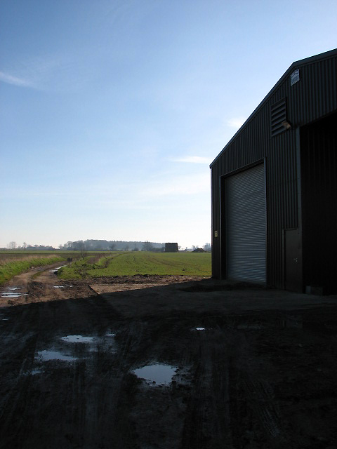Track past large farm shed