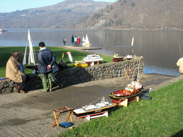 Model boat enthusiasts on the shores of Llyn Padarn