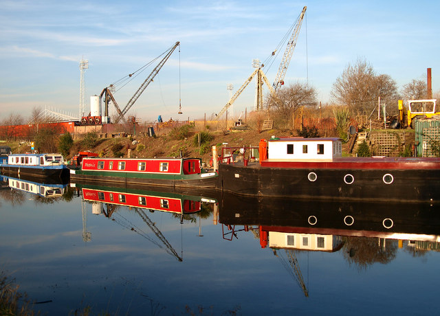 Houseboats reflected in the Sheffield and South Yorkshire Navigation