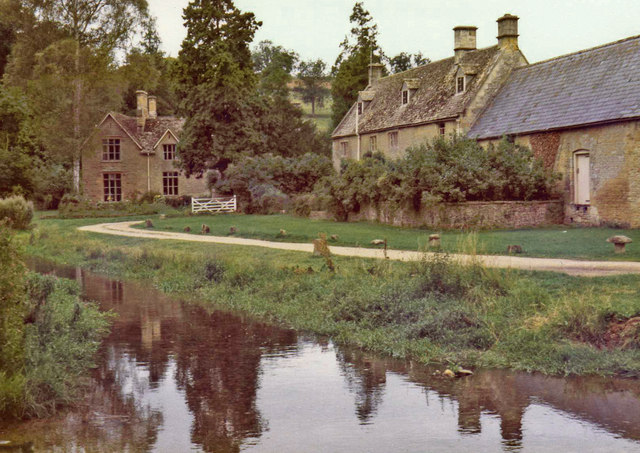 River Eye with houses alongside at Upper Slaughter, Gloucestershire