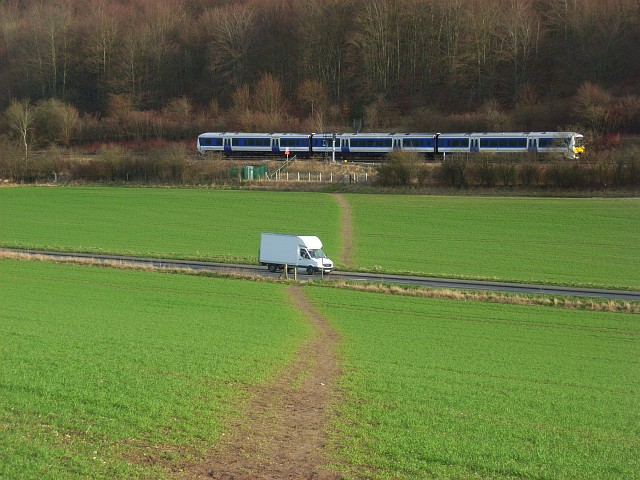 Footpath across farmland, the A4010 and the Chiltern Line, West Wycombe