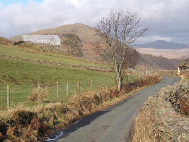 Lane towards Low Craghall, The Pike behind, Harter Fell in distance