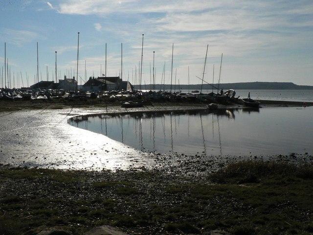 Mudeford: the mud catches the sun