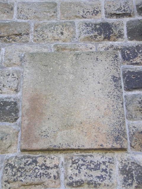 Enigmatic plaque
