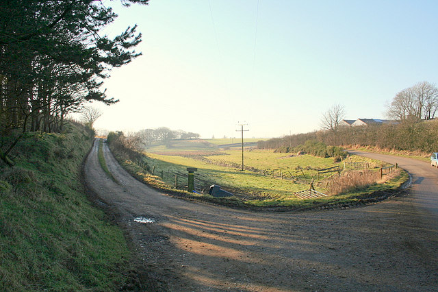 On the left, the lane to Cairns Farm; Tillyfar to the right