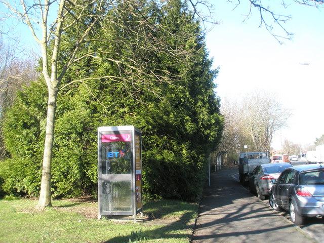 Phone box  on main road at Langstone