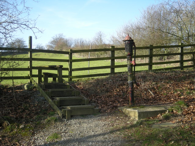 Old water-pump beside the path & stile